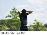 Купить «Soccer player standing with hand behind head», фото № 27193664, снято 26 июля 2017 г. (c) Wavebreak Media / Фотобанк Лори