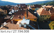 Купить «View from clock tower of Sighisoara tile roofs in sunny autumn day, Romania», видеоролик № 27194008, снято 7 октября 2017 г. (c) Яков Филимонов / Фотобанк Лори