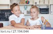 Купить «Boy with sister are playing in game at home.», видеоролик № 27194044, снято 11 августа 2017 г. (c) Яков Филимонов / Фотобанк Лори