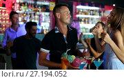 Купить «Female and male with cocktails dancing in the night club on party», видеоролик № 27194052, снято 11 августа 2017 г. (c) Яков Филимонов / Фотобанк Лори