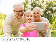 Купить «senior grandparents and granddaughter selfie», фото № 27194516, снято 9 августа 2017 г. (c) Syda Productions / Фотобанк Лори