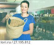 Купить «woman displayed big shopping bag with nuts in eco market», фото № 27195812, снято 13 июня 2017 г. (c) Яков Филимонов / Фотобанк Лори