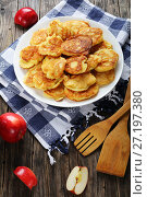 Купить «Pancakes loaded with pieces of apple», фото № 27197380, снято 23 октября 2017 г. (c) Oksana Zh / Фотобанк Лори