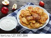 Купить «Pancakes loaded with juicy pieces of apple», фото № 27197384, снято 23 октября 2017 г. (c) Oksana Zh / Фотобанк Лори