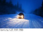 Купить «Car lights in winter forest», фото № 27197780, снято 28 декабря 2013 г. (c) Iakov Kalinin / Фотобанк Лори