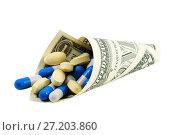 Купить «Таблетки и капсулы, завернутые в кулек из американского доллара», фото № 27203860, снято 8 июня 2010 г. (c) Александр Гаценко / Фотобанк Лори