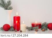 Купить «Christmas decoration with candles on white background», фото № 27204284, снято 13 ноября 2017 г. (c) Майя Крученкова / Фотобанк Лори