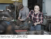 Купить «Girl worker is standing near vise equipment in workshop.», фото № 27204952, снято 10 октября 2017 г. (c) Яков Филимонов / Фотобанк Лори