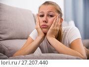 Купить «Girl is bored at lonely», фото № 27207440, снято 4 октября 2017 г. (c) Яков Филимонов / Фотобанк Лори