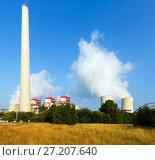 Купить «Industrial plant with chimney and cooling towers», фото № 27207640, снято 22 октября 2018 г. (c) Яков Филимонов / Фотобанк Лори
