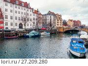 Купить «Quay of the Christianshavn canals in Copenhagen with boats, plea», фото № 27209280, снято 10 марта 2012 г. (c) Ольга Визави / Фотобанк Лори