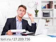 Купить «Business man with document in office», фото № 27209736, снято 21 апреля 2019 г. (c) Яков Филимонов / Фотобанк Лори