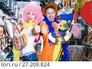 Купить «Smiling man and woman happy with the purchases», фото № 27209824, снято 11 апреля 2017 г. (c) Яков Филимонов / Фотобанк Лори