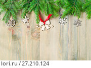 Купить «New Year and Christmas background. Christmas toys, green fir tree branches on the wooden background. New Year still life», фото № 27210124, снято 8 мая 2017 г. (c) Зезелина Марина / Фотобанк Лори