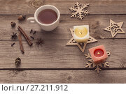 Купить «candles and Christmas decoration on wooden background», фото № 27211912, снято 14 ноября 2017 г. (c) Майя Крученкова / Фотобанк Лори