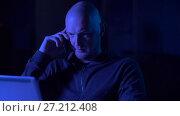 Купить «hacker with laptop calling on cellphone», видеоролик № 27212408, снято 12 ноября 2017 г. (c) Syda Productions / Фотобанк Лори