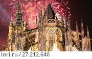 Купить «St. Vitus Cathedral (Roman Catholic cathedral ) and holiday fireworks -- Prague Castle and Hradcany, Czech Republic», видеоролик № 27212640, снято 17 ноября 2017 г. (c) Владимир Журавлев / Фотобанк Лори