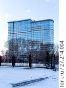 Купить «Modern multi-storey glass building», фото № 27214004, снято 31 марта 2017 г. (c) Евгений Ткачёв / Фотобанк Лори