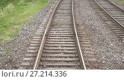 Купить «Railroad view from the window of the last railway carriage», видеоролик № 27214336, снято 17 ноября 2017 г. (c) Dzmitry Astapkovich / Фотобанк Лори