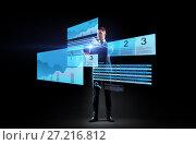 Купить «businessman with stock charts on virtual screens», фото № 27216812, снято 9 марта 2017 г. (c) Syda Productions / Фотобанк Лори