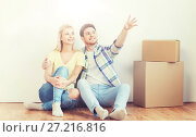 Купить «couple with boxes moving to new home and dreaming», фото № 27216816, снято 25 февраля 2016 г. (c) Syda Productions / Фотобанк Лори