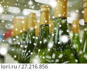 Купить «close up of bottles at liquor store», фото № 27216856, снято 2 ноября 2016 г. (c) Syda Productions / Фотобанк Лори