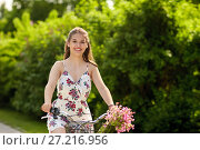 Купить «happy woman riding fixie bicycle in summer park», фото № 27216956, снято 17 июня 2017 г. (c) Syda Productions / Фотобанк Лори