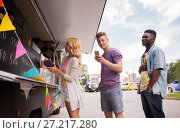 Купить «happy customers queue at food truck», фото № 27217280, снято 1 августа 2017 г. (c) Syda Productions / Фотобанк Лори