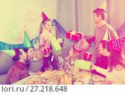 Купить «Large family presenting gifts to girl during birthday party», фото № 27218648, снято 25 мая 2018 г. (c) Яков Филимонов / Фотобанк Лори