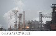 Купить «View of the metallurgical plant. Manufacture of cast iron and steel.», видеоролик № 27219332, снято 18 ноября 2017 г. (c) Андрей Радченко / Фотобанк Лори