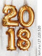 Купить «Bright metallic gold balloons figures 2018, Christmas, New Year Balloon with glitter stars on white wood table background», фото № 27220520, снято 19 ноября 2017 г. (c) Сергей Тимофеев / Фотобанк Лори