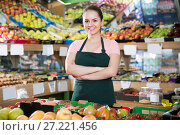 Купить «seller of vegetable store standing behind counter», фото № 27221456, снято 14 октября 2017 г. (c) Яков Филимонов / Фотобанк Лори