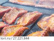 Купить «Meat ribs of pig roasting on barbecue», фото № 27221844, снято 30 апреля 2017 г. (c) Яков Филимонов / Фотобанк Лори