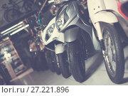 Купить «Image of modern different colors motorbikes in the shop», фото № 27221896, снято 17 июля 2017 г. (c) Яков Филимонов / Фотобанк Лори