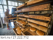 Купить «Workers of the Nikitin Kolkhoz bakery prepare bread, Ivanovka village, Azerbaijan. Bakery makes bread for local people. Children from school and kindergarden...», фото № 27222712, снято 8 сентября 2016 г. (c) age Fotostock / Фотобанк Лори