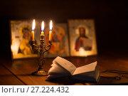 burning candle in a dark room, orthodox. Стоковое фото, фотограф Типляшина Евгения / Фотобанк Лори