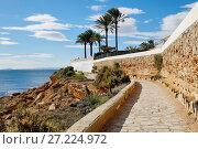 Купить «Paved promenade of Cabo Roig. Costa Blanca. Spain», фото № 27224972, снято 5 ноября 2017 г. (c) Alexander Tihonovs / Фотобанк Лори