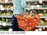 Купить «customer with food basket at supermarket», фото № 27233680, снято 2 ноября 2016 г. (c) Syda Productions / Фотобанк Лори