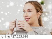 Купить «happy woman with cup or mug drinking at home», фото № 27233696, снято 24 ноября 2016 г. (c) Syda Productions / Фотобанк Лори