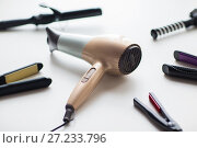 Купить «hairdryer, hot styling and curling irons», фото № 27233796, снято 12 апреля 2017 г. (c) Syda Productions / Фотобанк Лори
