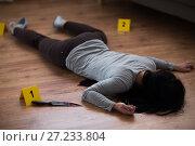 Купить «dead woman body lying on floor at crime scene», фото № 27233804, снято 5 мая 2017 г. (c) Syda Productions / Фотобанк Лори