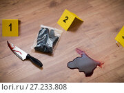 Купить «knife in blood and evidence marker at crime scene», фото № 27233808, снято 5 мая 2017 г. (c) Syda Productions / Фотобанк Лори
