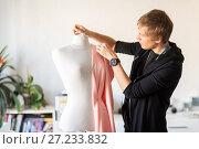 Купить «fashion designer with dummy making dress at studio», фото № 27233832, снято 28 июня 2017 г. (c) Syda Productions / Фотобанк Лори
