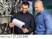 Купить «customer and salesman at car service or auto store», фото № 27233848, снято 21 сентября 2017 г. (c) Syda Productions / Фотобанк Лори