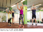 Купить «group of people exercising and jumping in gym», фото № 27233884, снято 19 февраля 2017 г. (c) Syda Productions / Фотобанк Лори