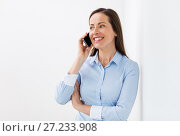 Купить «businesswoman calling on smartphone at office», фото № 27233908, снято 22 апреля 2017 г. (c) Syda Productions / Фотобанк Лори