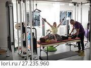 Купить «Инструктор центра доктора Бубновского занимается на тренажере с женщиной», эксклюзивное фото № 27235960, снято 24 ноября 2017 г. (c) Дмитрий Неумоин / Фотобанк Лори