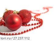 Купить «Christmas decorations of red color on a white background - balls and beads», фото № 27237112, снято 23 ноября 2017 г. (c) Юлия Бабкина / Фотобанк Лори