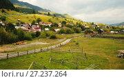 Купить «Image of Sadova village on Bucovina in Romania.», видеоролик № 27237264, снято 6 октября 2017 г. (c) Яков Филимонов / Фотобанк Лори
