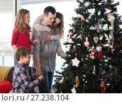 Купить «Charming family members preparing for Christmas», фото № 27238104, снято 23 декабря 2016 г. (c) Яков Филимонов / Фотобанк Лори